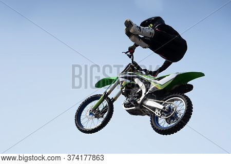 Man In A Helmet Performs A Stunt In The Air On A Motorcycle