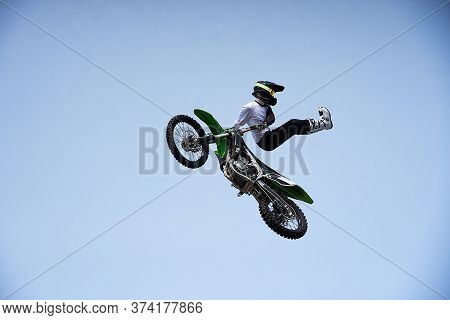 Rider In A Helmet Makes A Risky Jump In The Air On A Motorcycle