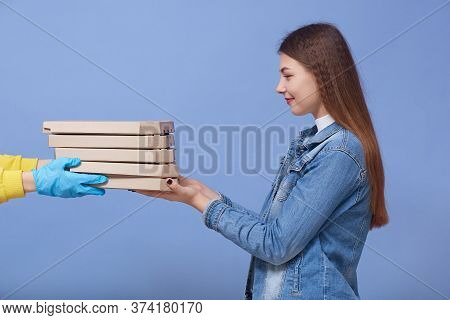 Side View Of Dark Haired Female Receiving Food Order, Lady In Denim Jacket Gets Carton Boxes With Pi