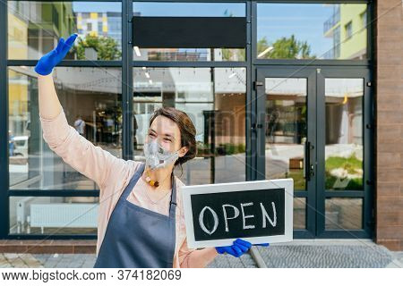 Business Owner Woman Wear Protective Face Mask Holding Open Sign At Her Zero Waste Grocery Shop Outd