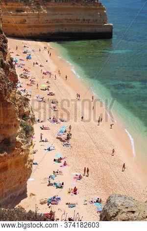 Algarve, Portugal - May 31, 2018: Tourist Crowd Visits Marinha Beach In Algarve Region, Portugal. Co