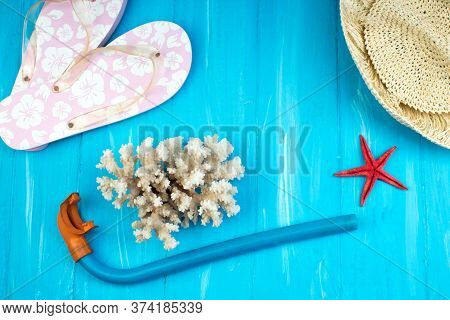 Straw Hat, Sunglasses And Beach Slippers On Wood. Top View And Copy Space.
