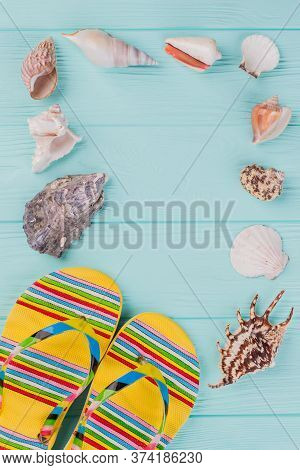 Along The Perimeter Are Different Sea Shells And Bright Sandals In The Corner On Turquoise Backgroun