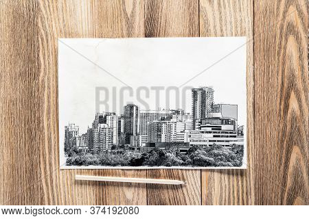 Big City Skyline Pencil Draw On Textured Wooden Background. Panorama Of Modern Downtown With High Of