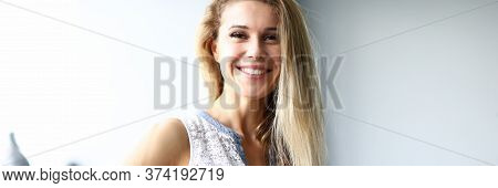Portrait Of Happy Woman Looking At Camera With Calmness And Happiness. Smiling Female Person Playing