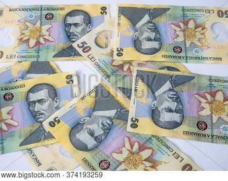 Many 50 Ron Or Lei Romanian Banknotes On White Background. Romanian Currency.