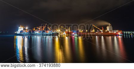 Papeete, French Polynesia - October 2, 2018: Night Shot. Papeete Port With Loading Cranes And Cargo