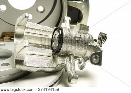 Brand New Brake Caliper And Brake Discs Set For Car. Isolated On White.