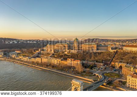 Aerial Drone Shot Of Buda Castle On Buda Hill During Budapest Sunrise Morning Glow