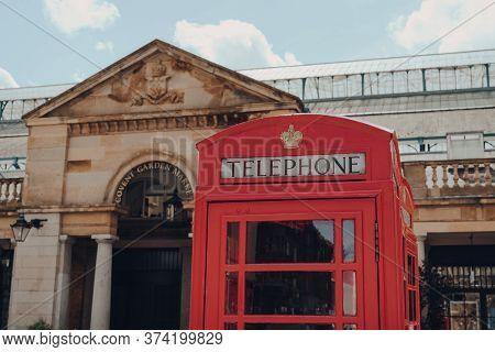 London, Uk - June 13, 2020: Red Phone Box, Covent Garden Market On The Background. Red Phone Boxes C