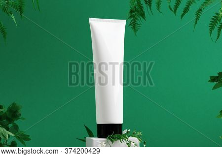 Unbranded Container On Shopfront. Plastic Tube For Toiletry. Tropical Leaves On Background. Flacon F