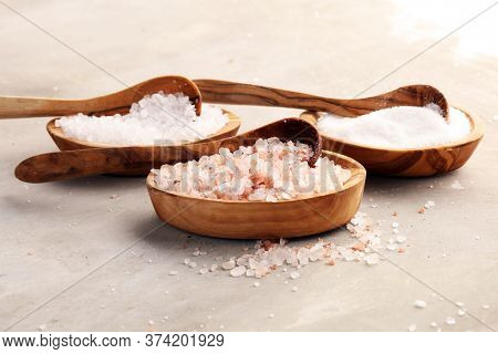 Sea Salt And Himalayan On Spoon. Crystals Of Salt On Background