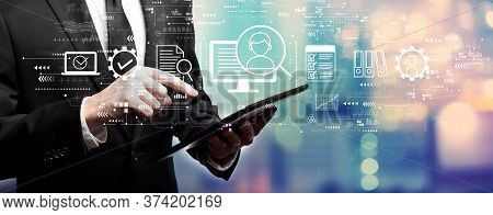 Document Management System Concept With Businessman Using His Tablet Computer