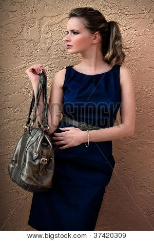 Wealthy fashionable luxury woman with a purse or handbag