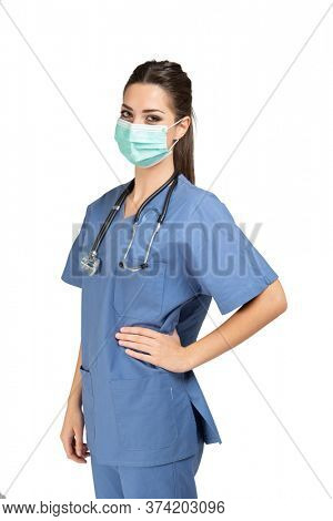 Healtcare worker with stethoscope isolated on white wearing a mask, coronavirus pandemic concept