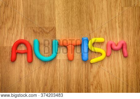 Autism. Autism Spectrum Disorder. The Word Autism Made Out Of Play Clay. Close Up.
