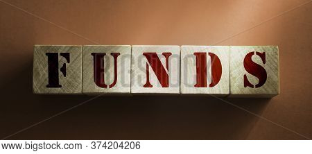 Wooden Cubes With Word Funds On Brown Background. Funding And Business Concept