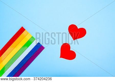 Lgbt Rainbow Flag And Red Heart On A Blue Background. Lgbt Concept. Lgbt Movement Symbol