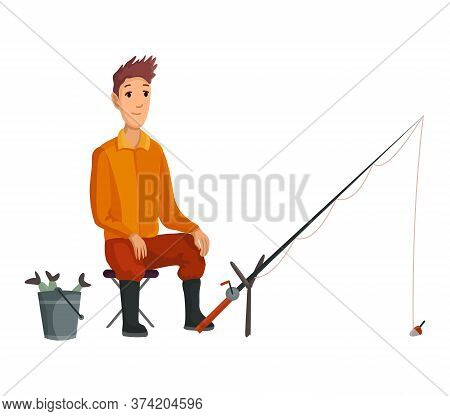 Young Fisherman Seating With Fish Rod And Wait Bite.caughted Fish In A Bucket. Successful Fishing
