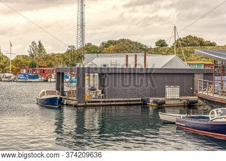 A Modern Houseboat And Other Boats In The South Harbour Of Copenhagen, October 12, 2019