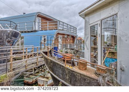 Gangway To Old Rusty Houseboats, Surrounded With Scrap In The South Habour Of Copenhagen, October 12