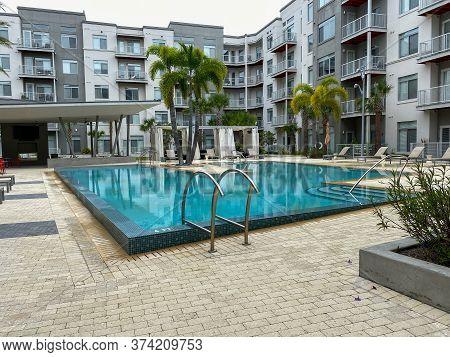 Orlando, Fl/usa - 6/20/20:  The Pixon Apartment Complex Swimming Pool Amenity Area In The Lake Nona
