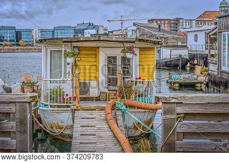 Gangway To A Romantic Houseboat With Flowers On The Porch In The South Habour Of Copenhagen, October