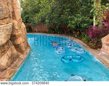Orlando, Fl/usa - 6/18/20:  People Floating Down The Lazy River At Seaworld Aquatica After The June