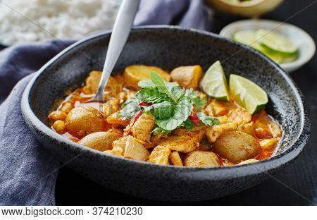 thai massaman curry with chicken and potatoes in bowl