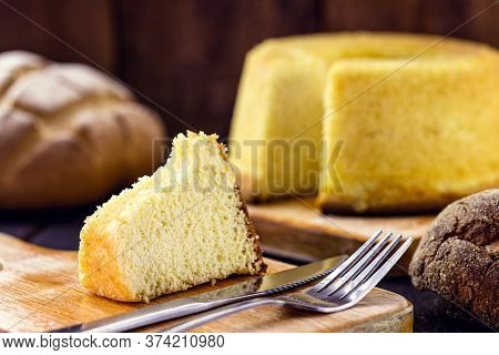 Slice Of Brazilian Corn Cake Made With A Type Of Corn Flour (fuba). Traditional Homemade Cake From B