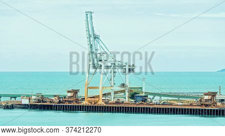 Townsville, Queensland, Australia - June 2020: Industrial Wharf With Ship Loading Facilities For Imp