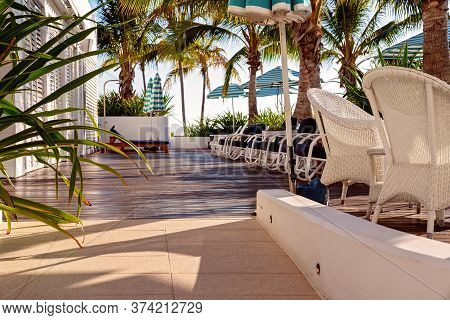 Townsville, Queensland, Australia - June 2020: A Casual Poolside Setting With Lazy Chairs For Guests