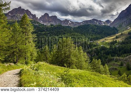 Footpath In Alps  In Claree Valley In Hautes Alpes, Nevache, France. In The Background There Is The