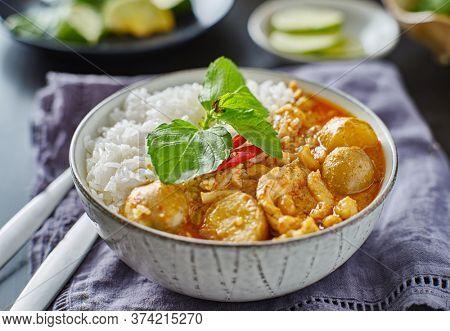 thai massaman chicken curry in bowl with jasmine rice