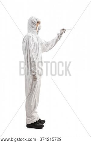 Full length profile shot of a man in a hazmat suit holding a cotton swab test isolated on white background