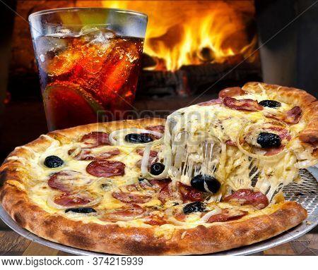 Pepperoni pizza with mozzarella, black olives, onion and cola soda