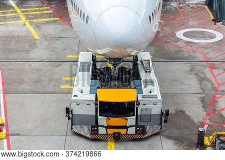 Pushback From The Front Landing Gear Of A Jumbo Jet Airplane At The Boarding Gates In Frankfurt Airp