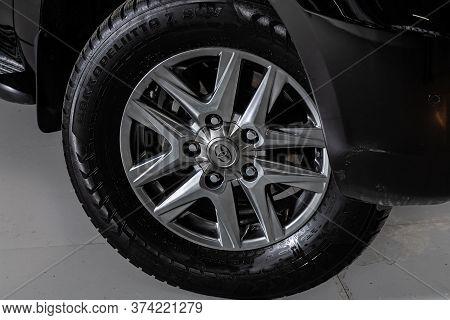 Novosibirsk/ Russia - April  02 2020: Toyota Land Cruiser 200  ,   Car Wheel With Alloy Wheel And Ne