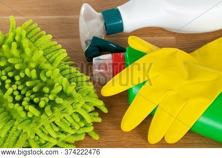 Picture Of Colorful Cleaning Supplies On Wooden Background