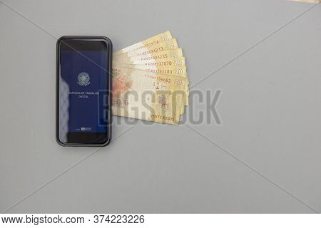 June 27, 2020, Brazil: Top View Of Cellphone And Real Banknotes - Brazilian Work Document And Social