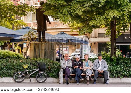 Larissa, Thessaly, Greece - May 4th, 2018: Four Senior Men Sitting In A Bank Placed In The Kentriki