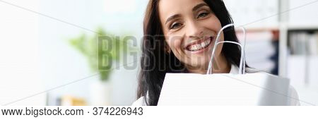 Cute Girl In Office Presses Package And Laughs. Shopping Plan Agreed. Escort For Shopping. Business