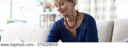 Woman Holding Credit Card While Sitting With Laptop. Opening Web Page And Following Link. Computer L