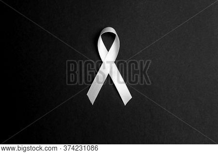 Lung Cancer Awareness Ribbon On Black Background. November Lung Cancer Awareness Month. Black And Wh