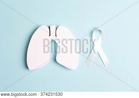 White Lung Cancer Awareness Ribbon And Lung Symbol On Blue Background. November Lung Cancer Awarenes