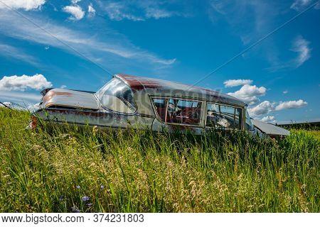 Wymark, Sk/canada- June 28, 2020:  Abandoned Vintage Nash Rambler Blue Sedan In The Tall Grass On A