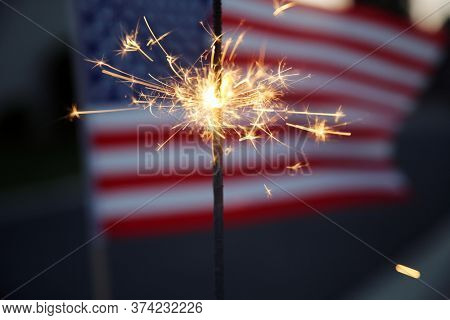 American flag lit up by sparklers for 4th of July celebrations. Fourth of July, Sparkler, Pyrotechnics. Independence Day Celebration in America.