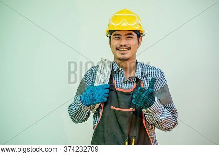 Electrician,smiling Electrician In Helmet And Safety With Cabling And Tools On White Background.