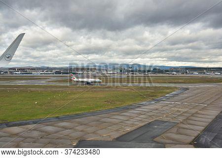FRANKFURT AM MAIN, GERMANY - CIRCA JANUARY, 2020: British Airways aircraft taxing at Frankfurt am Main Airport as seen from Lufthansa aircraft.