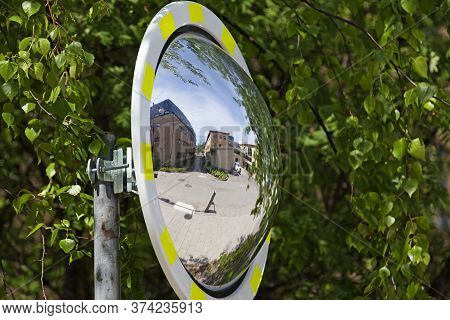 Umea, Norrland Sweden - June 10, 2020: A Convex Traffic Mirror Where You Can See Parts Of The Campus